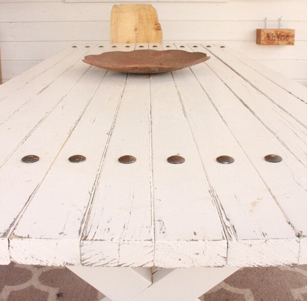 This picnic table with industrial farmhouse flair is the center of my porch decor. Come see how simple it can be to update an unloved table. | Twelveonmain.com