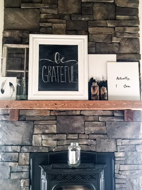Create a farmhouse mantle by updating frames with chalk paint.
