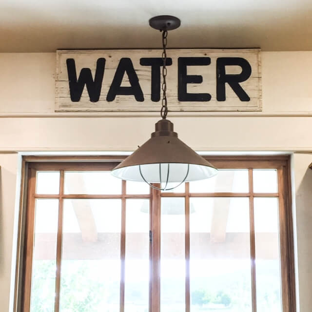 Give an old sign, a fresh new farmhouse look.