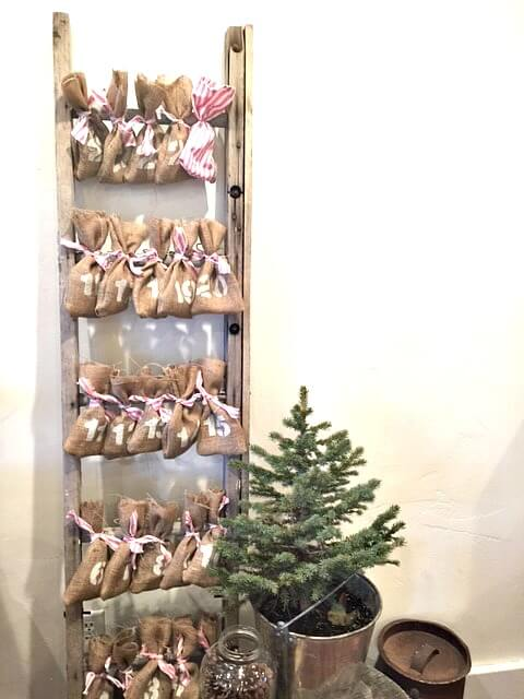Reusable advent calendar with a ladder and burlap!