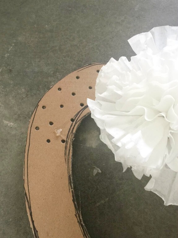 How to make an easy coffee filter wreath with upcycled items from your home.