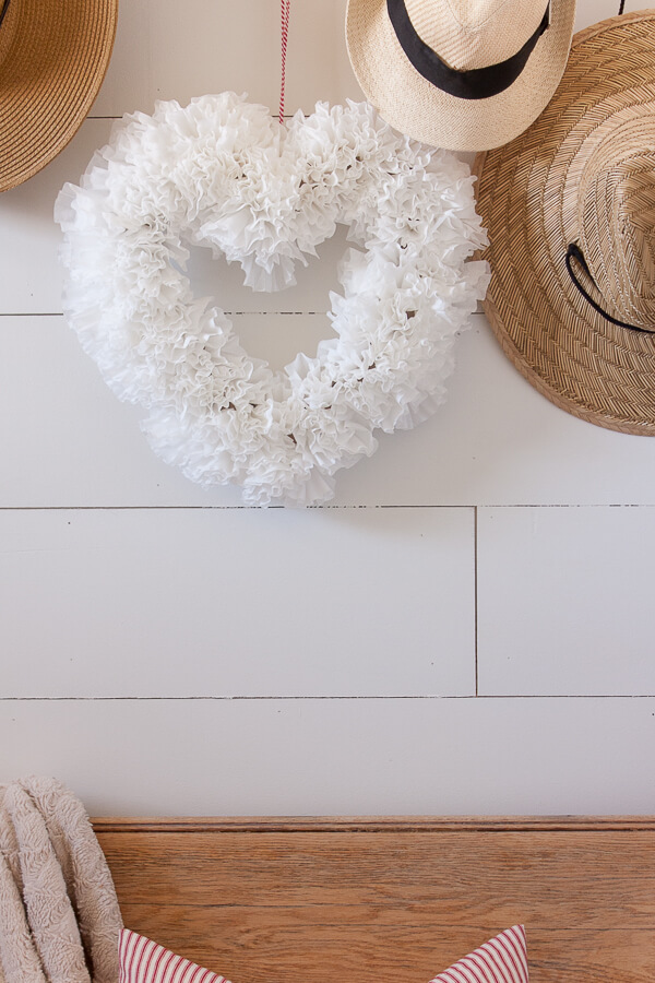 Make this super easy coffee filter wreath for Valentines day, even if you hate to decorate!  This is an easy way to add a bit of festive decor to your home.