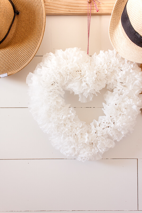 Make this super easy coffee filter wreath for Valentines day, even if you hate to decorate!  This is an easy way to add a bit of festive Valentines Day decor to your home.