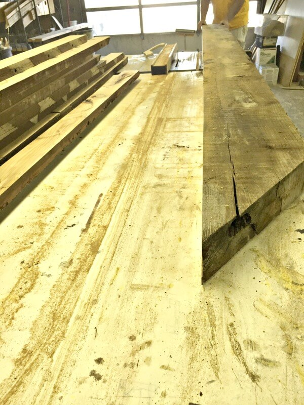 Can you believe this old beam was turned into amazing butcher block countertops? Check them out!