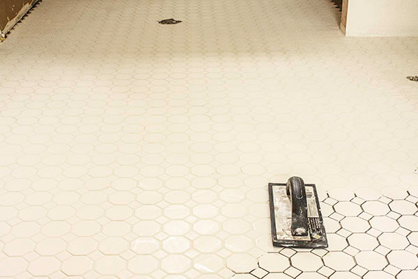 Grout tile like a pro! Don't let tile intimidate you, it is easier than you think! | Twelveonmain.com
