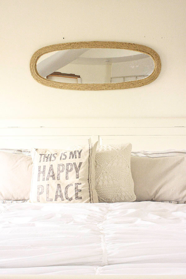 This thrift store mirror makeover is a great update to an otherwise drab and boring mirror. The perfect farmhouse accent.   Twelveonmain.com