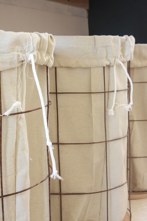 DIY wire laundry baskets with drop cloth liners. These were made in one afternoon and