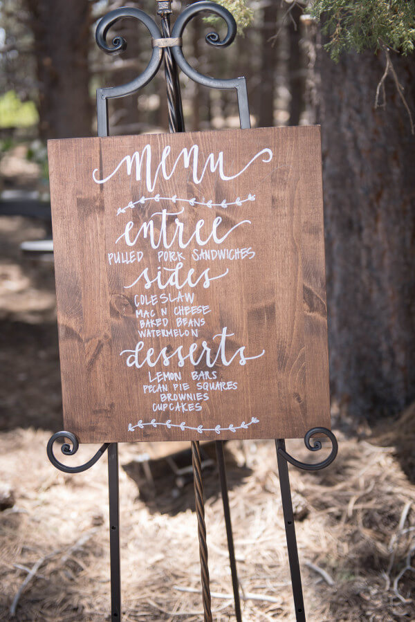 What a creative way to display the menu at an outdoor woodland wedding. Beautiful.
