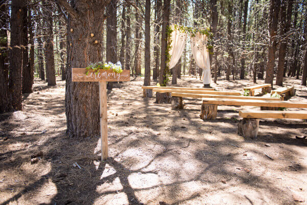 These handmade signs were made for all the different spaces for a beautiful outdoor woodland themed wedding.