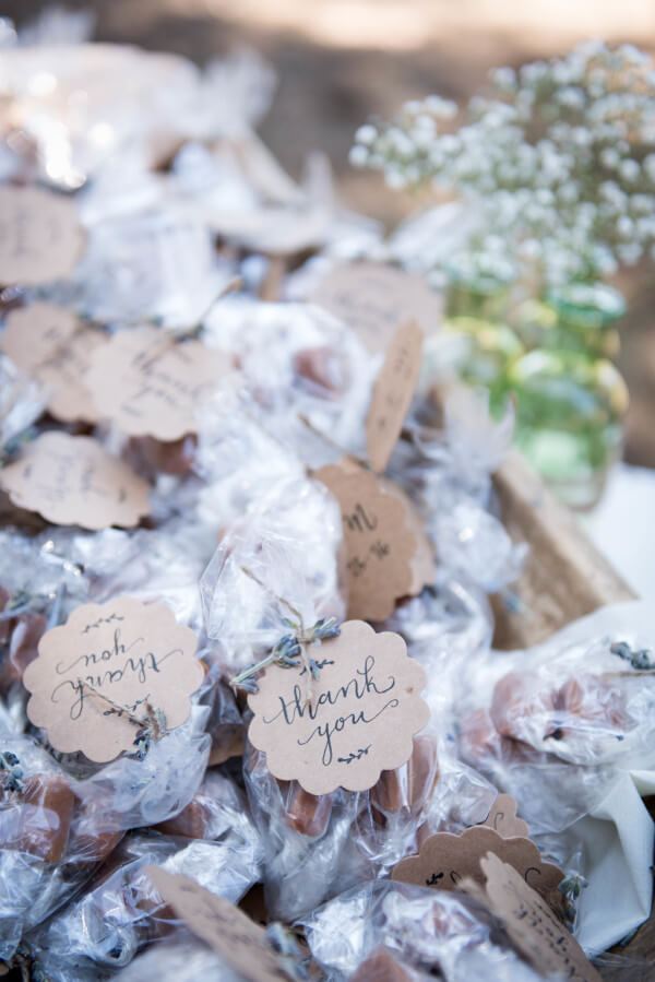 Handwritten thank you cards on party favors for this outdoor woodland wedding.