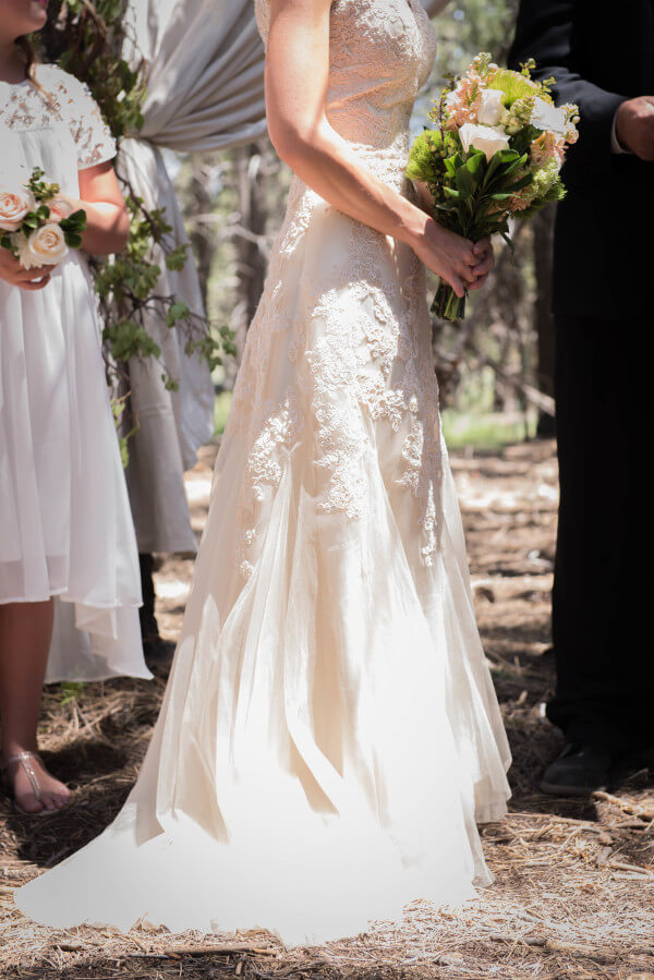 Here comes the bride. Beautiful soft blush wedding dress for her outdoor woodland themed wedding.