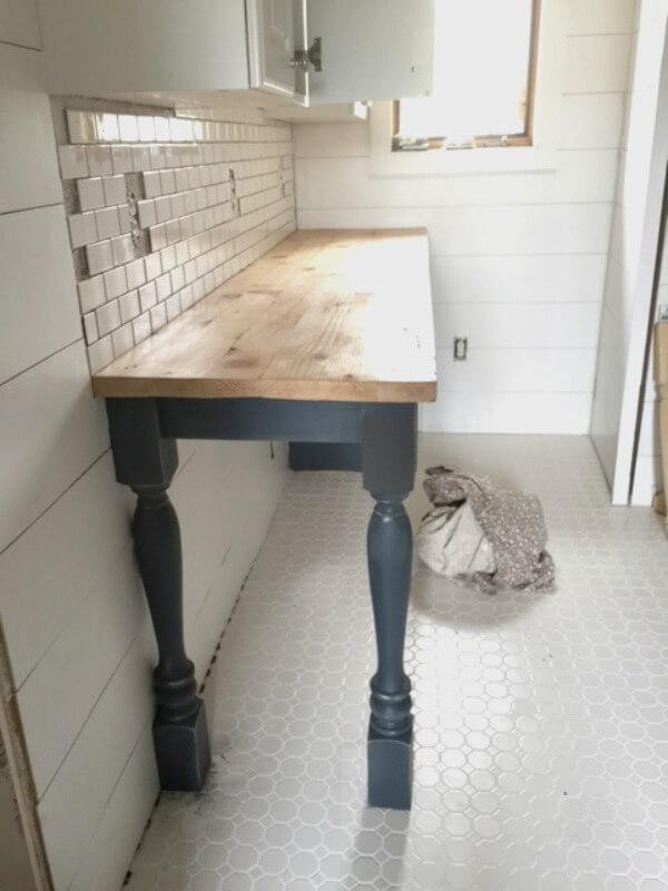 Sealing butcher block countertop with wax.