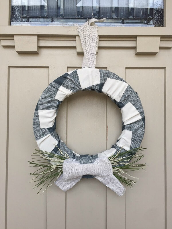 This farmhouse style buffalo check holiday wreath is the prefect addition to your decor this Christmas!