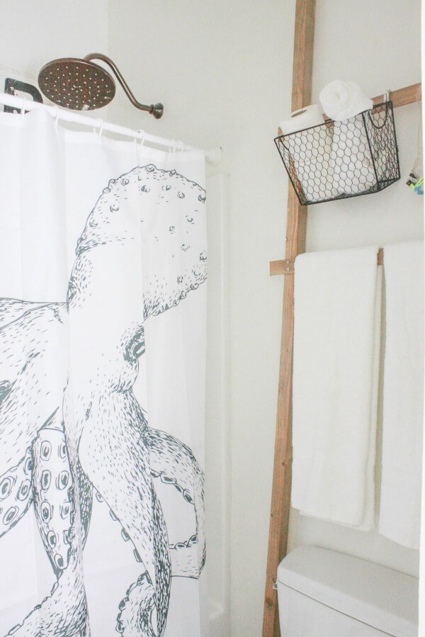 I love the combination of whimsy and rustic in this amazing budget friendly bathroom makeover! | Twelveonmain.com
