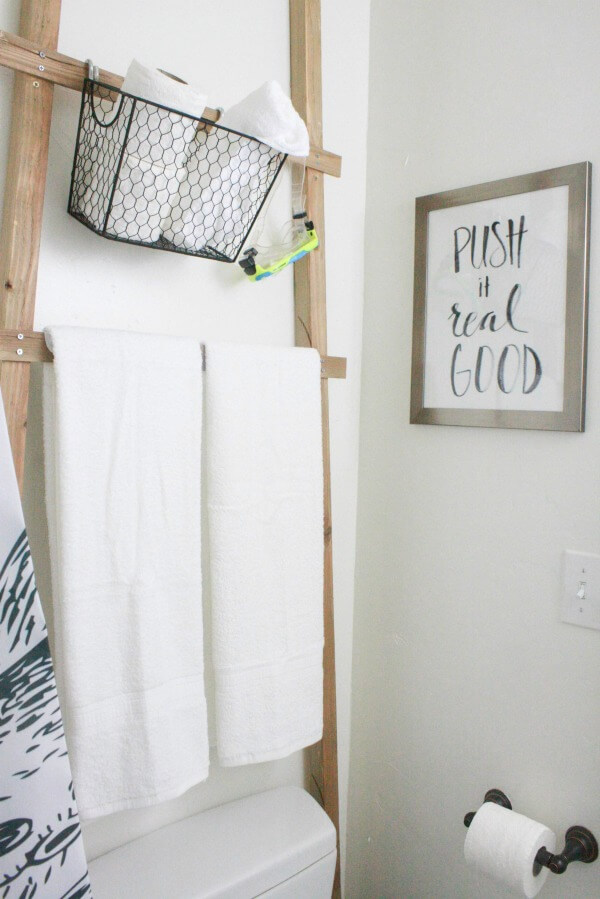 My kids love this hilarious artwork in this budget friendly bathroom makeover!