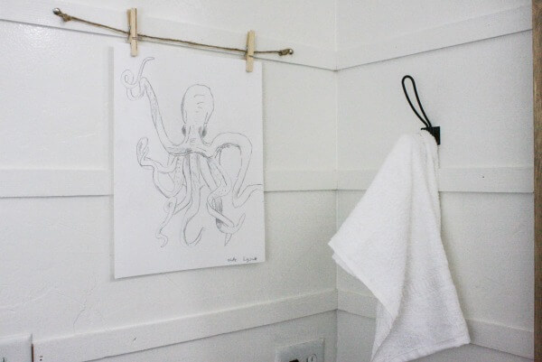 Can you believe my 9 year old created the artwork for this budget friendly bathroom makeover?