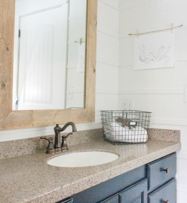 Customizing this mirror was a big part of this budget friendly bathroom makeover.