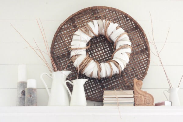 The neutral look and lush texture of this DIY farmhouse wreath is perfect.