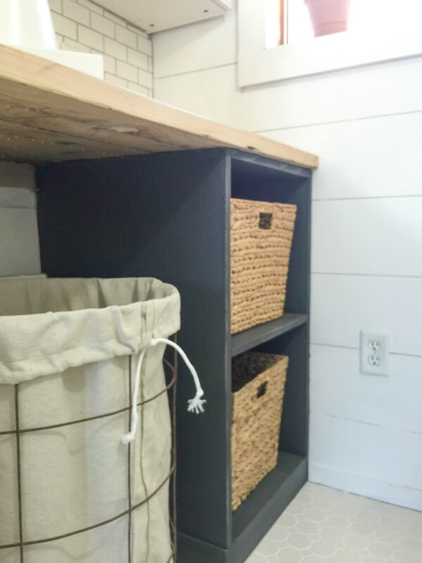 This DIY laundry folding table has great storage!