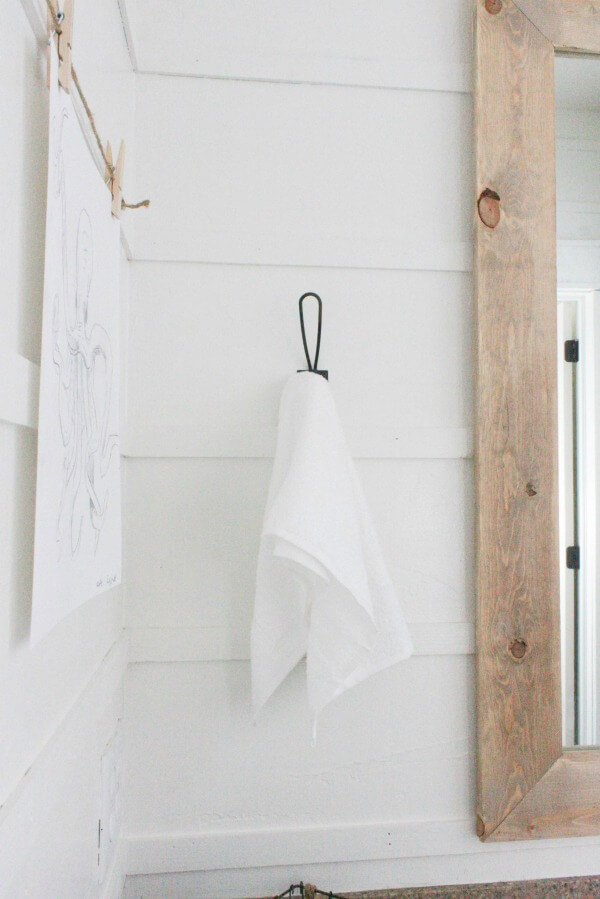 Try this alternative to shiplap! Easy and inexpensive DIY reverse shiplap is the best new thing!