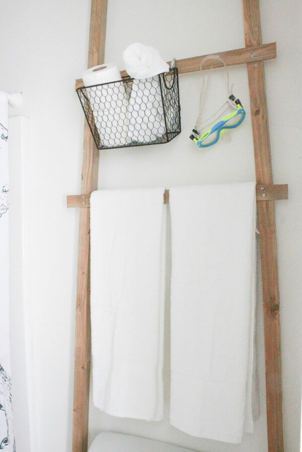 make this over the toilet towel storage ladder its easy and so stylish and you - Towel Storage