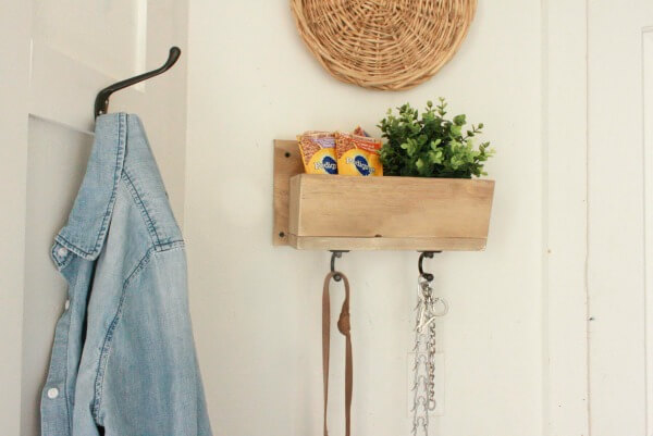 If you are a dog lover, you will love this DIY dog leash and treat holder! It is so easy to make and is functional and stylish!