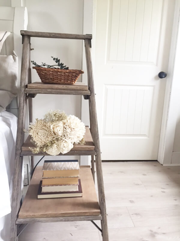 Rustic farmhouse nightstand made from an old salvaged ladder.