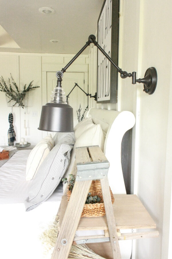 farmhouse master bedroom | swing arm wall lamps | wall lamps | farmhouse bedding | white bedroom | ticking stripe