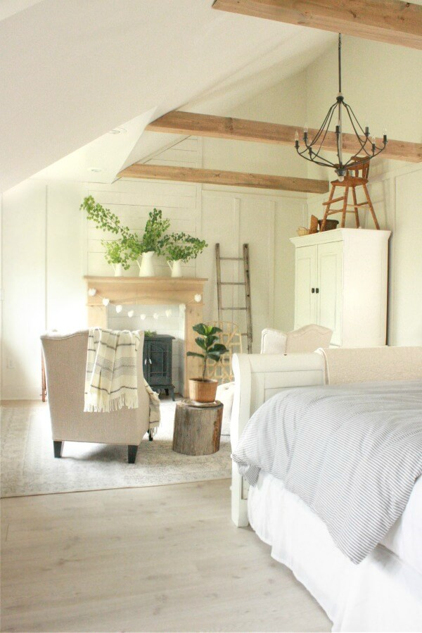 Farmhouse Master Bedroom | bright and cozy bedroom | master bedroom | farmhouse style | faux beams | faux fireplace | farmhouse bedroom | master bedroom remodel | master bedroom makeover | white bedroom