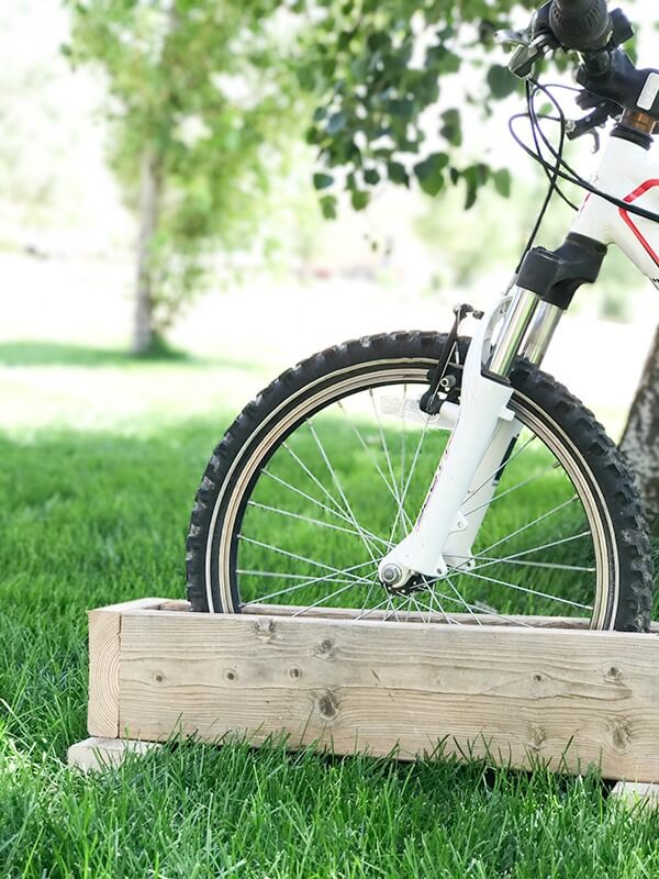 Get your kids bikes off the grass with this easy DIY bike rack! So easy to make, I made it in 10 minutes!
