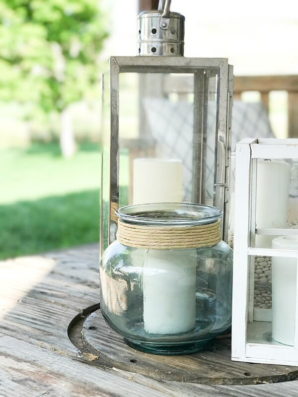 Simple lanterns make a great outdoor centerpiece filled with candles. Imagine how lovely at night!