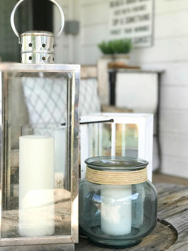 Love these lanterns as an addition to their farmhouse summer porch decor!