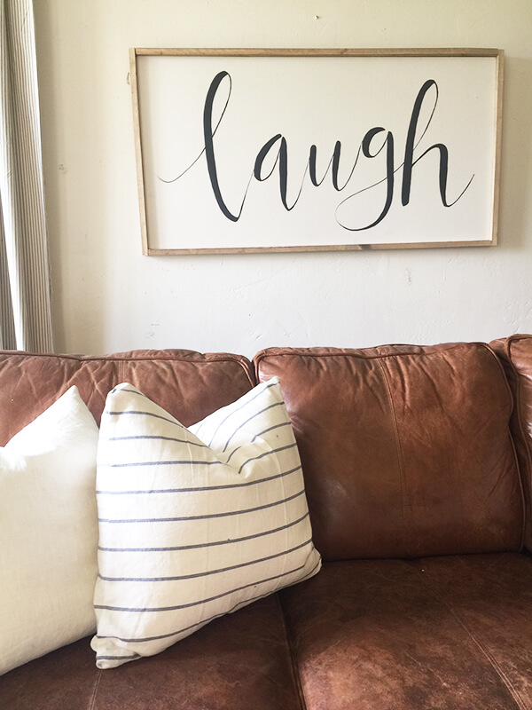 Add farmhouse style to your home with this easy DIY large farmhouse sign. Its simple, clean lines would fit in any decor!