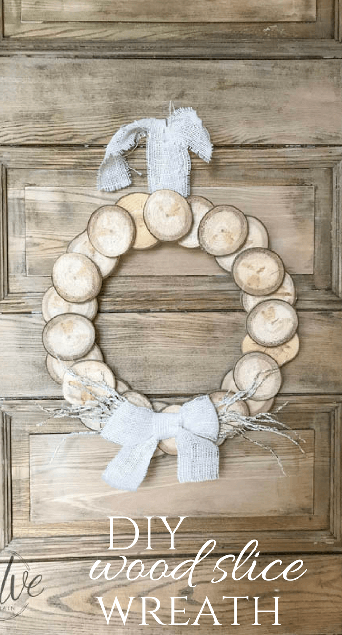 I love this easy DIY wreath made with wood slices! With its rustic wood detail and neutral farmhouse style its perfect for any space! These are so easy to make and they can look great for fall, or any time of year! Make one for yourself!