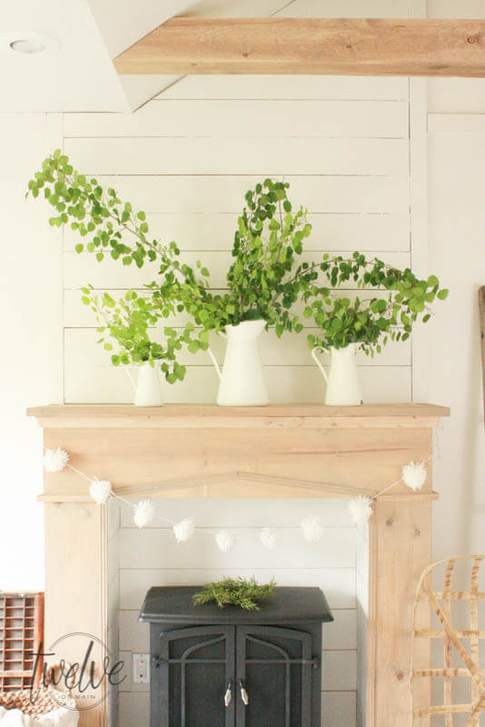 Add warmth, character and style to your home with this easy farmhouse style DIY faux fireplace and mantel. Raw wood, shiplap, and a freestanding fireplace!