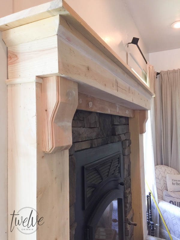 Stone fireplace surround gets a farmhouse facelift twelve on main you have to see how they tansformed this fireplace into a farmhouse style stacked stone fireplace solutioingenieria Image collections