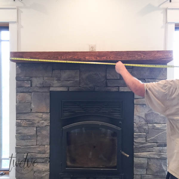 You have to see how they transformed this stone firepalce surround into a farmhouse style stacked stone fireplace. Love the shiplap accents and the handmade corbels!