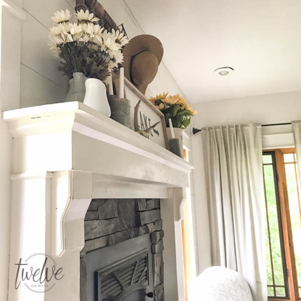 You have to see how they transformed this stone fireplace surround into a farmhouse style stacked stone fireplace. Love the shiplap accents and the handmade corbels!