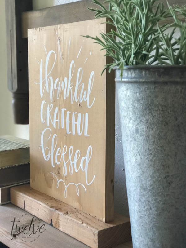 This farmhouse style reversible wood sign was so easy to make and its the perfect rustic piece for your home.