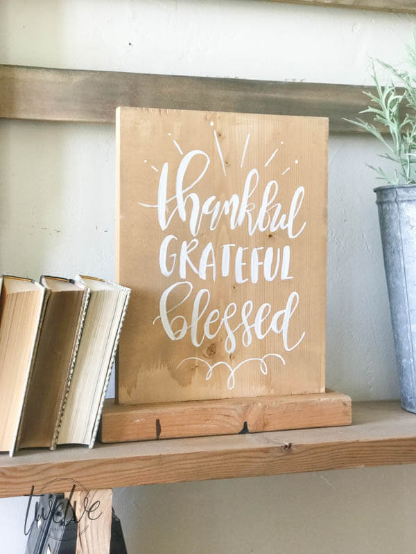 Thankful, grateful, blessed. This farmhouse style reversible wood sign was so easy to make and its the perfect rustic piece for your home.