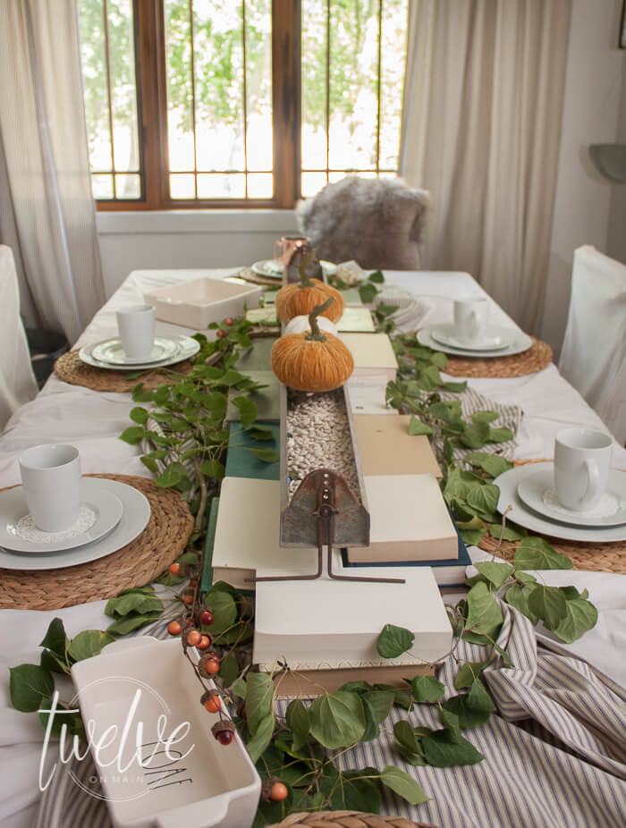 Want to create the perfect farmhouse style fall table? Check out these awesome tips! Books, ticking stripe,and nature inspired elements!