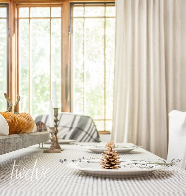 Simple Farmhouse Fall Dining Room Featuresticking Stripe Fabric White Pumpkins