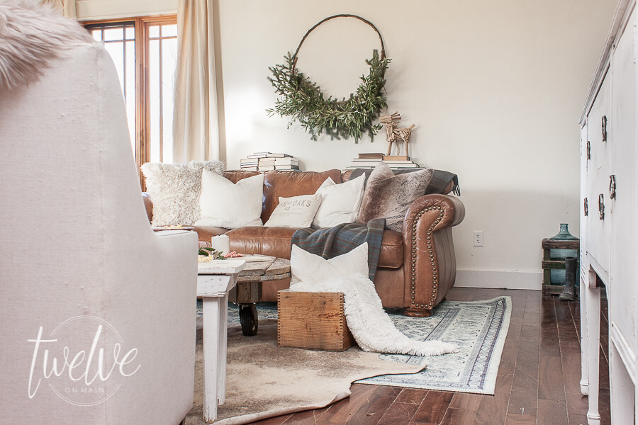 Farmhouse Christmas living room with handmade evergreen swag