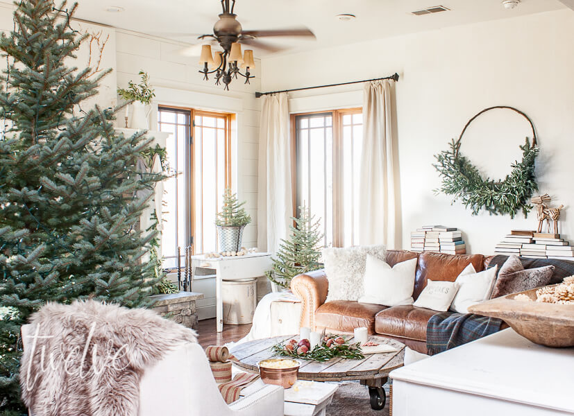 When you take a fantastic rug, lots of evergreen, fur rugs, rustic wood, and white accents, you get my cozy and simple farmhouse Christmas living room decor