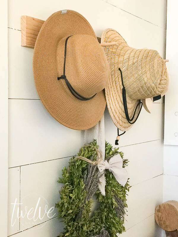 Make this easy DIY peg coat and hat rack in less than 20 minutes and for less than $10 dollars!  This is a stylish place to store your winter coats and hats!