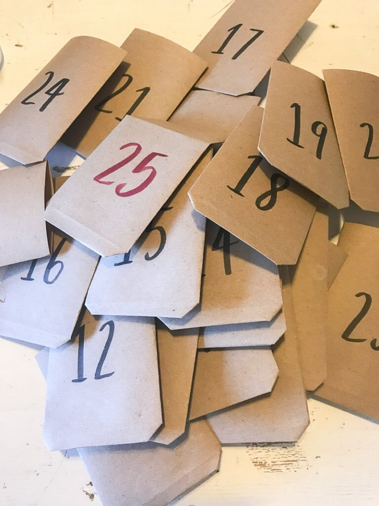 Handmade paper envelopes for a simple Christmas advent calendar.