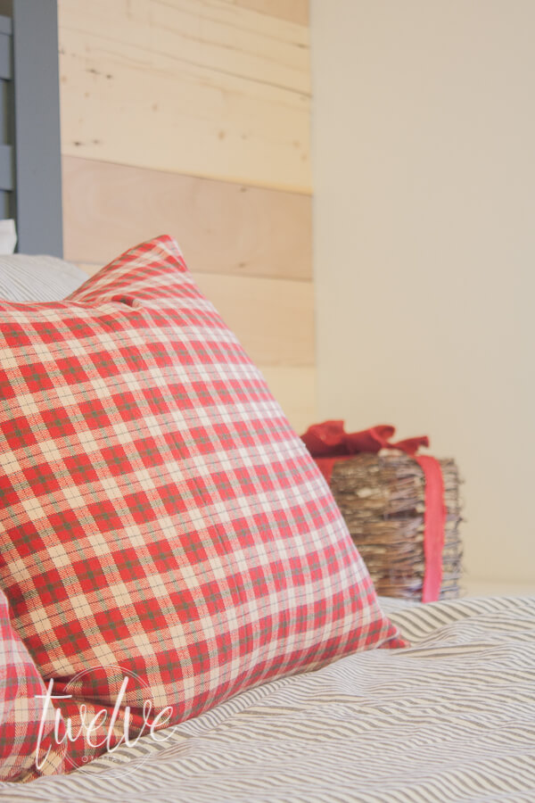 Christmas pillows made from red plaid fabric from the fabric store is an inexpensive way to add Christmas decor to a bedroom.