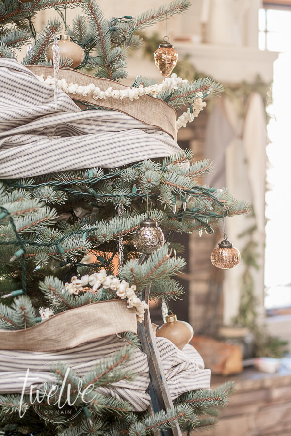 Ticking stripe fabric, linen ribbon, popcorn garland, all thrown together to create an amazing farmhouse style Christmas tree.