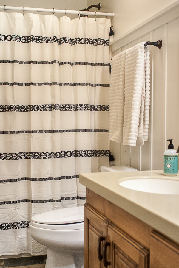 New towels, a new white and black tribal inspired shower curtain, and a few other simple bathroom decor ideas can completely transform a space.