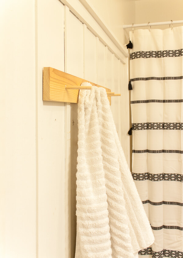 Create an easy DIY peg towel rack to hang your towels on!